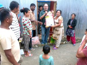 Nepal-earthquake-handing-out-supplies-August-2015